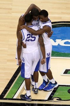 NEW ORLEANS, LA - MARCH 31: Marquis Teague #25, Doron Lamb #20 and Terrence Jones #3 of the Kentucky Wildcats embrace at midcourt following the Wildcats 69-61 victory against the Louisville Cardinals during the National Semifinal game of the 2012 NCAA Division I Men's Basketball Championship at the Mercedes-Benz Superdome on March 31, 2012 in New Orleans, Louisiana.