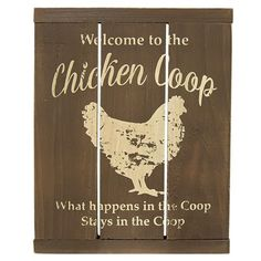 """The Chicken Coop Slat Sign features a distressed chicken silhouette and the phrases """"Chicken coop"""" and """"what happens in the coop stays in the coop"""" printed on the wood slats. Measures 13¼"""" high by 10½"""