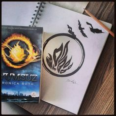 despite probably being more erudite in mind, i'd still pick dauntless at my ceremony. i don't necessarily think i'd be divergent despite holding the values of each faction strongly (maybe no so much amity but eh). anyway. i'd love his tattoo minus the ring around he flames. i'd likely be leaving my family behind if i chose dauntless and the birds fit my family as well. i'd probably make it look more like the birds are coming out of the flames though...