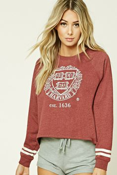 """A heathered fleece knit PJ top featuring a """"Harvard Veritas est. 1636"""" front graphic, long raglan sleeves with varsity striping, and a boxy silhouette."""