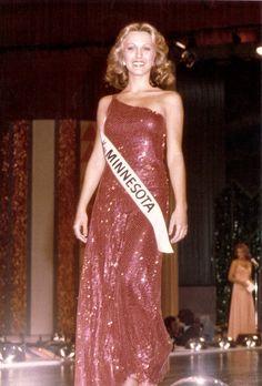 Dorothy Benham, Miss America 1977, modeling her evening gown.
