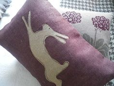 hand printed muted mulberry leaping  hare cushion by helkatdesign, $76.00