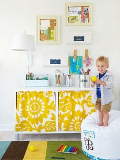 Hide the cabinet messes in your kids' play area with floral curtains that also work to soften the space.