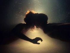 an underwater kiss.