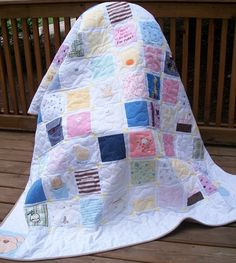 This is why I'm saving all those baby clothes!  My husband thinks I'm crazy, but when my kids have babies, they're going to get quilts made out of their parent's baby clothes!!  Too cool!