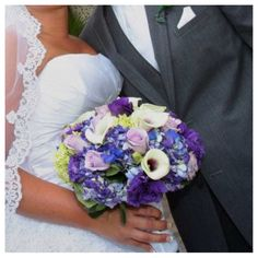 Lavender to blue hydrangea, Picasso calla Lillies, blue delphinium, lavender roses,  Blue to lavender bridal bouquet   www.myfloralimpressions.com Follow us on Facebook