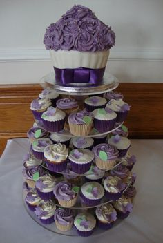 Giant Cupcake Wedding Tower @Beth J J J Wheeler thought  you might like this one.