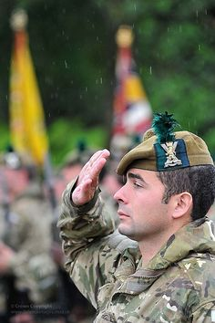 5 SCOTS Soldier Salutes Regimental Colours During Homecoming Parade in Dumbarton, Scotland