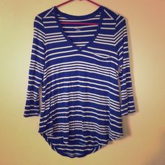 Casual pocket tee Has cute pocket on front. Stretchy material. High low. 95% rayon 5% spandex. Tag says xs but will fit S or M. Merona Tops Tees - Long Sleeve