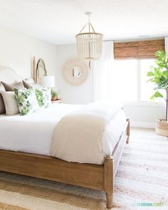 Loving everything about this space with a wooden beaded chandelier, striped duvet cover, palm leaf pillows, fiddle lead tree, and rattan mirror! Guest Bedroom, Bedroom Inspirations, Home Bedroom, Bedroom Interior, Master Bedrooms Decor, Green Bedroom Decor, Bedroom Decor, Bedroom Green, Wooden Bedroom