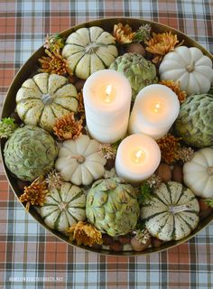 Easy table centerpiece with tray and candles, artichokes, hydrangeas, mini pumpkins, mums, and nuts | homeiswheretheboatis.net