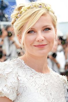 "KIRSTEN DUNST    ""I always love a soft, textured updo with a shiny accessory,"" says Guido. ""It provides contrast and makes a style statement."""
