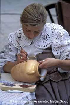 Woman painting a vase, Cracow, Polan