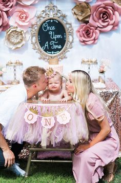 Once Upon A Time 1st Birthday Party idea. Cute pink and gold high chair decorations. Princess Party. Pink Princess smash cake with gold number 1 candle. | Touch of Pink