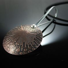 Etched copper pendant with riveted silver bail - Students work - 3 day jewellery making workshop at La Vidalerie May 2016 - Etching, riveting, fold forming & more - Fabulous jewellery by Fiona. Salt water etch method. #etching #saltwateretch #jewellerymakingworkshop #etched #pendant