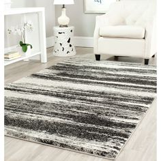 Give any room a modern look with this museum-inspired gray contemporary area rug. The rug features a dark grey background with contrasting shades of lighter grays and cotton canvas backing. It measures 8 feet by 10 feet with a 0.5-inch pile height.