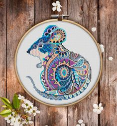 This is modern cross-stitch pattern of Mandala Mouse for instant download.  You will get 7-pages PDF file, which includes: - main picture for your reference; - colorful scheme for cross-stitch; - list of DMC thread colors (instruction and key section); - list of calculated thread