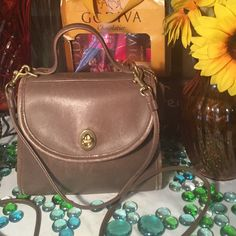 Vintage Coach Crossbody Bag Authentic Vintage Coach Bag- Sz 8x3x8- Hangtag attached- Taupe color- Exterior minor wear along the sides- Good condition- 3' handle- 25' Strap- Suede interior in good condition. Super cute bag! Coach Bags Crossbody Bags