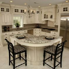 An ivory, black and stainless steel kitchen . . . so beautiful, but I can't imagine trying to keep it clean!