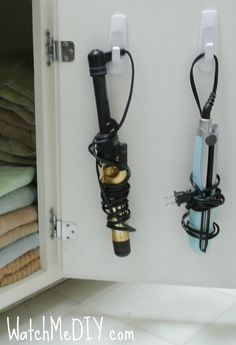 Hang your curling irons on a hook attached to cabinet door - bjl