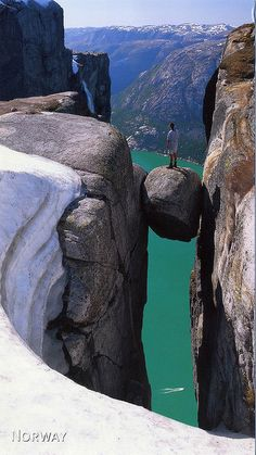 "Kjeragbolten is a 5 m³ boulder wedged in a mountain crevasse by the edge of the Kjerag mountain (59°2′0.83″N 6°35′32.79″E) in Norawy. It is possible to walk onto the rock without any equipment, but there is a direct 241 m drop below and then another 735m gradient down to Lysefjorden. The name means ""Kjerag Boulder"" or ""Kjerag Bolt"". The wonders of nature. #geology"