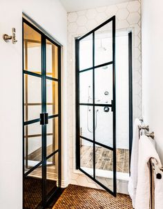Iron and glass door shower.