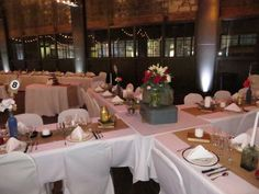 Cleverly arranged and beautifully decorated guest tables at Jackie and Ben's wedding reception on December 21, 2014 at the Jamestown Gateway Train Station in Jamestown, NY.