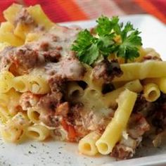 Ziti pasta is layered with Provolone, mozzarella, cottage cheese, sour cream and a meaty sauce with ground beef and sausage.