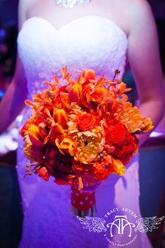 The Bridal Experience: Orange and yellow fall themed flower wedding bouquet idea. By tamiwinn.com (photo by TracyAutem.com)