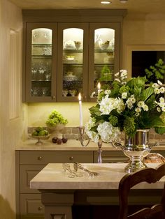 Here's a beautiful design for kitchen cabinets which illuminate the china inside. (houzz.com)