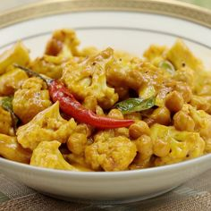 Recipe with video instructions: Curried cauliflower makes for a perfect meatless Monday meal. Ingredients: 1 medium sized cauliflower, chickpeas, 2 cm piece of ginger, 1 clove garlic, Curry Recipes, Indian Food Recipes, Vegetarian Recipes, Cooking Recipes, Healthy Recipes, Ethnic Recipes, Cauliflower And Chickpea Curry, Meatless Monday, Brunch