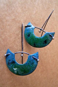 personal note...leather, copper. dangling beads...Enamel Earrings - just think of them in pc.