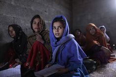 Afghan refugee girls listen to their teacher, during an English language class at their school near Islamabad, on December (AP Photo/Muhammed Muheisen) English Language Classes, Refugee Stories, Pakistani Girl, Global Citizen, Muslim Girls, Foreign Policy, Story Inspiration, Color Photography, People Around The World