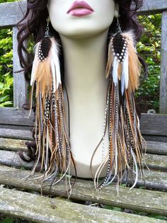 Handmade Extra Long Feather earrings - Owlita Inspired Forest Pixie 14 inch thick full big natural rooster feather earrings Ready To Ship. $225.00, via Etsy.