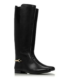 """""""This streamlined equestrian style features a slender gold metal band at the heel, detailed with a signature logo."""""""