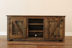 Rustic barn-style doors make our convenient entertainment piece a true eye-turner. Enclosed storage on the outside plus open shelves in the middle.