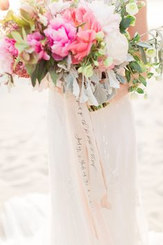 "For a truly personalized bouquet, Alyssa Thiel, owner of Parris Chic Boutique, wrapped the stems with a customized ribbon. ""We wrote 'The voice of the seas speaks to the soul' in calligraphy to reflect the seaside location and the way the ocean can make you feel alive,"" she explains. Related: 50 Ideas for Beach Weddings"