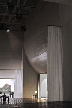 View out from stage into foyer and city behind; Felipe Fankhauser Bergental // by ETH Tom Emerson Studio