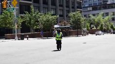 Cop dancing in the street 8 July 2014 New York