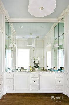 Clean and classic white bathroom designed by Beth Webb