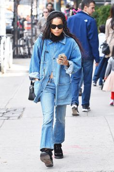 Zoë Kravitz wears Alexander Wang's cropped flared jeans, an oversize denim jacket, and black lace-up boots