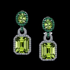 Robert Procop Exceptional Jewels Peridots are framed with diamond and tsavorite borders in these stunning earrings.