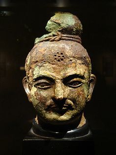 3rd-4th C.  Head of Buddha found in Khotan in the Tarim Basin along the SIlk Route. Here we see the central asian Kushan facial features and top-knot with western and prob, Chinese influence. Xinjiang, China. The Tokyo National Museum