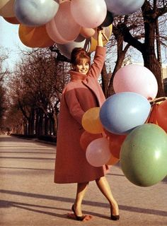 Claudia Cardinale, what a great swing coat!