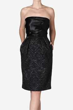 Raven Brocade & Satin Luxe Cocktail Dress. The classic LBD is reworked with brocade and satin detailing, creating a perfect after hours cocktail number.  A cinched waist and subtle bubble skirt create a hourglass silhouette. Complete the luxe look with a sleek ponytail and statement drop earrings.