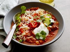 Game-Day Chili : Don't let the name fool you; you don't have to be watching football to enjoy Geoffrey Zakarian's hearty, meaty chili (though it will score touchdowns at your tailgate). He brightens up the bowl by serving it with fresh scallions, plus classic chili fixings like fragrant cilantro, diced tomatoes and shredded cheeses.