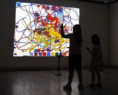 """Children create a digital painting with the """"Kinection Project"""" in the Sheldon Museum of Art. (Troy Fedderson, University Communications)"""