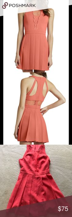 BCBG Deep V Lace Fit and Flare Dress Pretty lace, pleats and cutout details elevates the standard fit and flare dress to uber feminine levels. Lace cutouts front and back rounded neck line sleeves. Banded waist pleated skirt. Fits true to size hits above knee 34 from top hem and bottom hem very slight stretch Machine washable. Coral color tag color is called salmonwine new with tags BCBGeneration Dresses