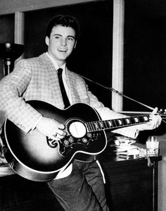 """On this date in 1957, a then 16-year-old Ricky Nelson sang for the first time on """"The Adventures of Ozzie and Harriet,"""" the popular ABC sitcom he starred in with his parents Ozzie and Harriet Nelson and older brother David. Nelson performed the Fats Domino's hit """"I'm Walkin'."""" Nelson's take on the tune hit No. 4 on the charts launching his singing career. Photo of Nelson courtesy of AP"""