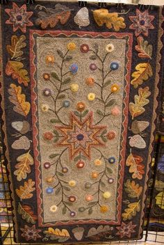 Hand hooked rug.  Beautiful.  My grandmother designed and made them.  Such an art.....would love to make them.